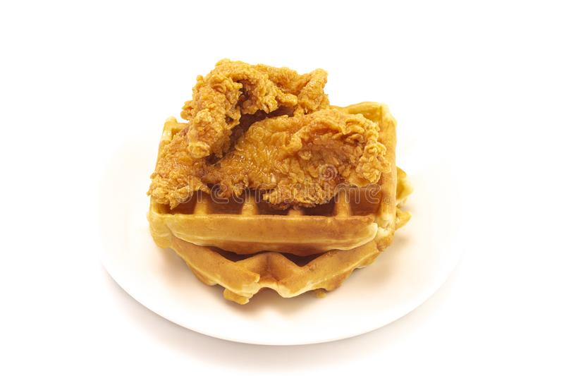 Pile of Chicken and Waffles Isolated on a White Background. A Pile of Chicken and Waffles Isolated on a White Background royalty free stock photo