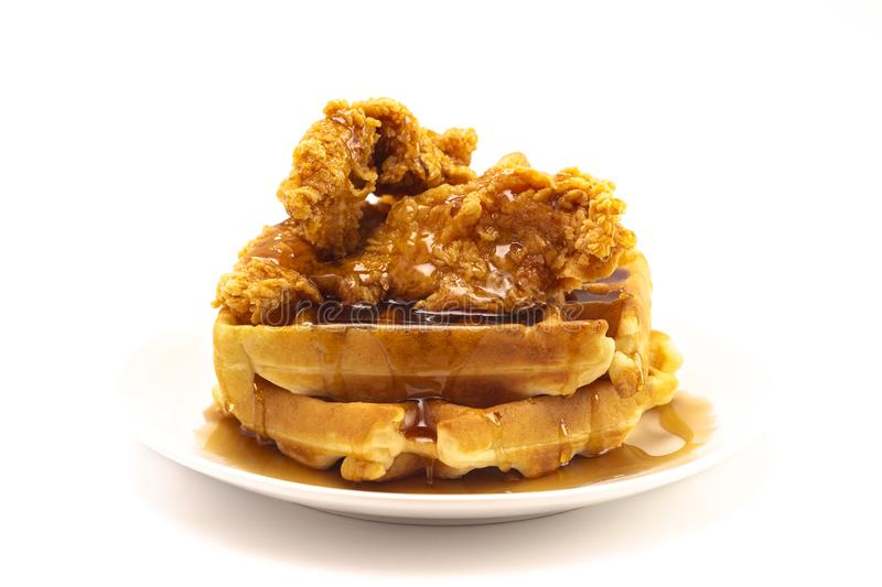 Pile of Chicken and Waffles Isolated on a White Background. A Pile of Chicken and Waffles Isolated on a White Background stock photos