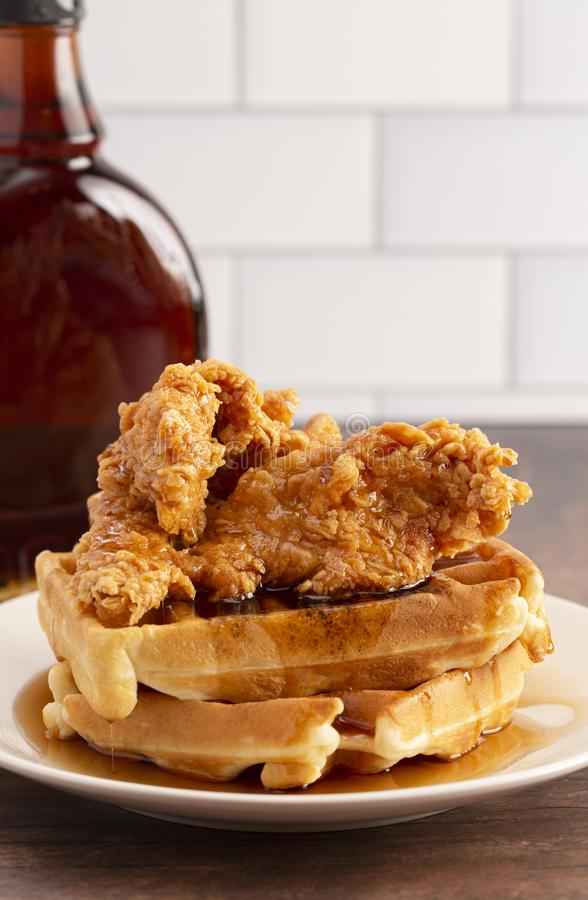 Pile of Chicken and Waffles on a Rustic Wooden Counter. A Pile of Chicken and Waffles on a Rustic Wooden Counter stock photos