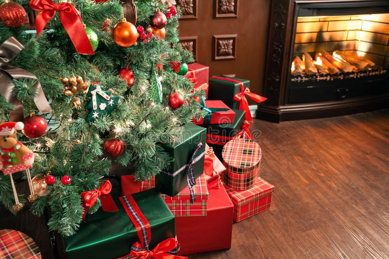 Pile of Christmas gifts close-up under the Christmas tree. red and green presents.  royalty free stock photography