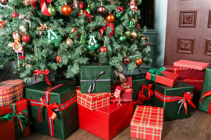 Pile of Christmas gifts close-up under the Christmas tree. red and green presents.  stock photos