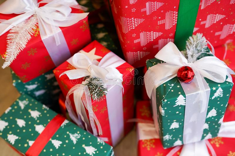A pile of Christmas gifts in colorful red and green wrapping with ribbons royalty free stock photography