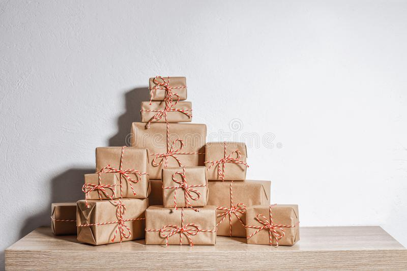 A pile of Christmas gifts wrapped in rustic paper stock photography