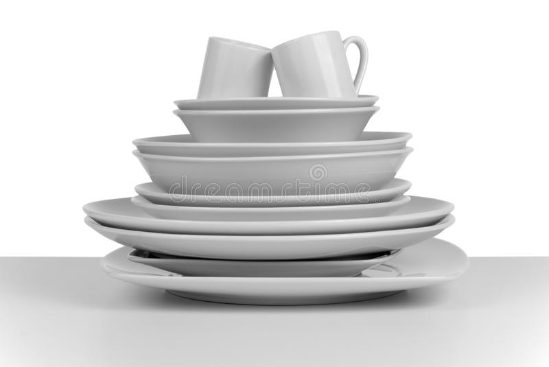 Pile of clean empty dishes and cups royalty free stock images