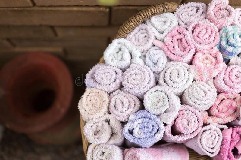 Pile of cloth, hand towel in wooden basket. Background, bath, bathroom, beauty, bright, care, clean, closeup, dry, fabric, handkerchief, home, hygiene, luxury royalty free stock images