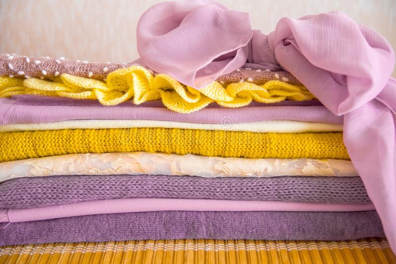 Pile of clothes on table. yellow purple purple and pink royalty free stock photography