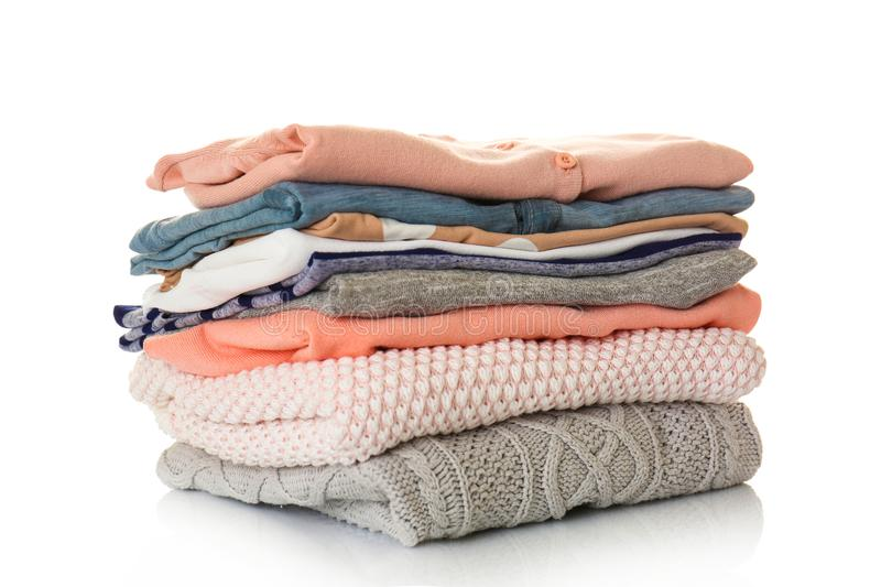 Pile of clothes on background. Pile of clothes on white background royalty free stock photos