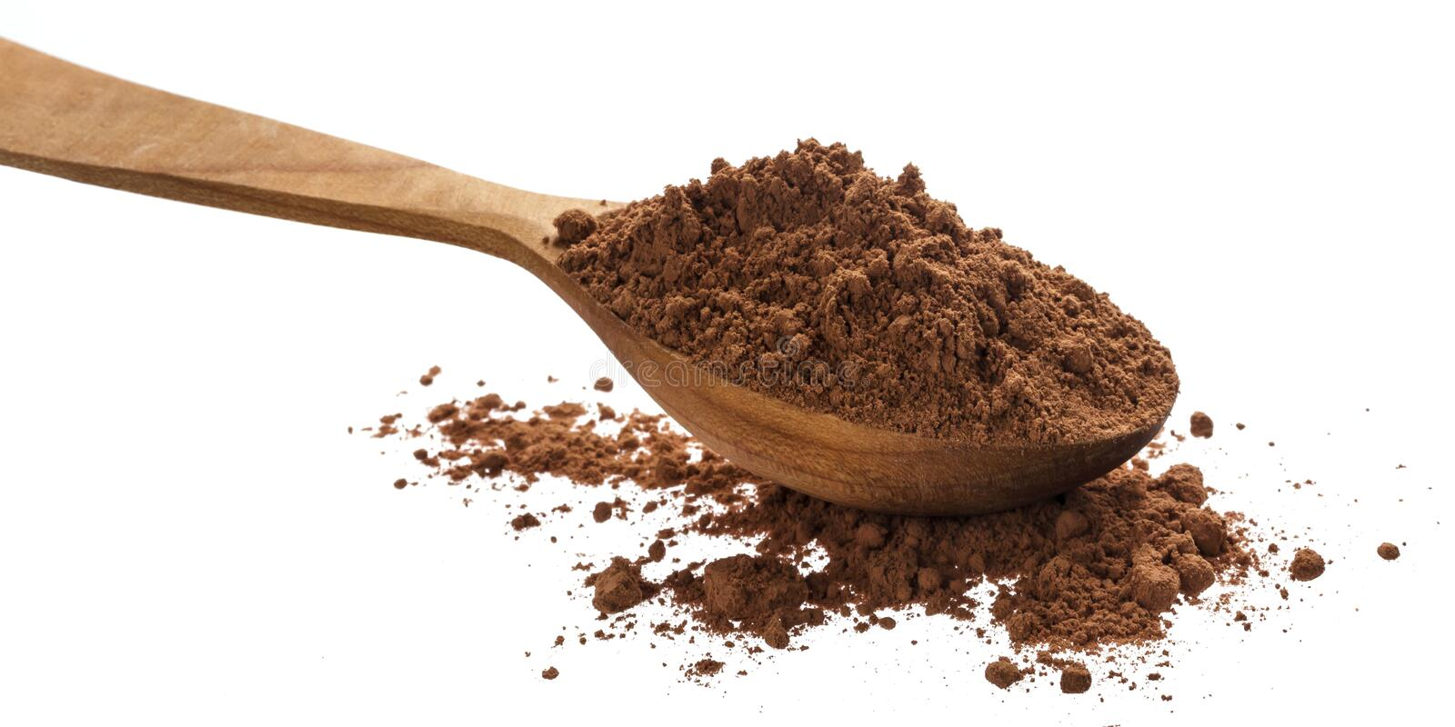 Pile of cocoa powder isolated on white background, cinnamon powder in wooden spoon stock photography