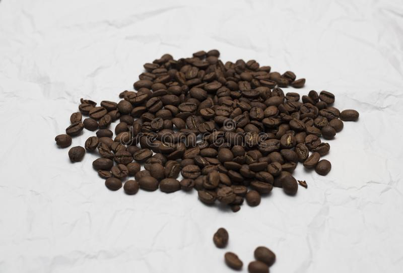 Pile coffee beans isolated on white background royalty free stock image