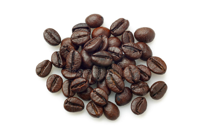Pile of coffee beans (Robusta coffee). Over white background. Overhead view royalty free stock photos