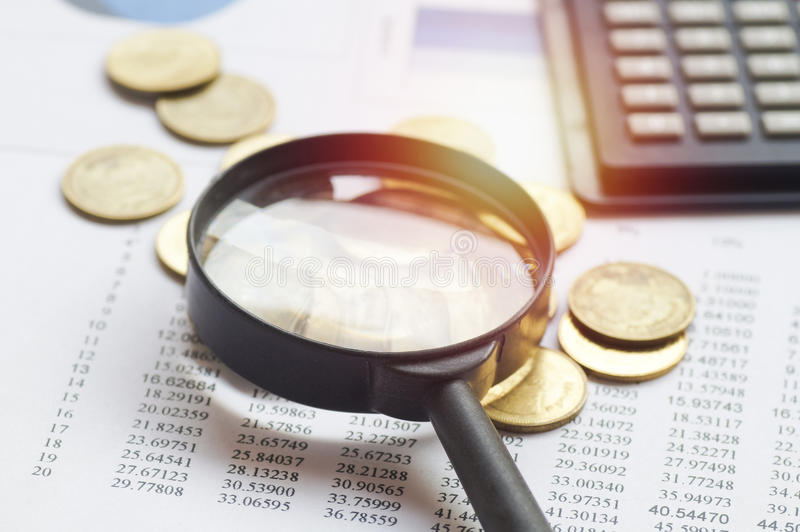 pile coin money and magnifier royalty free stock images