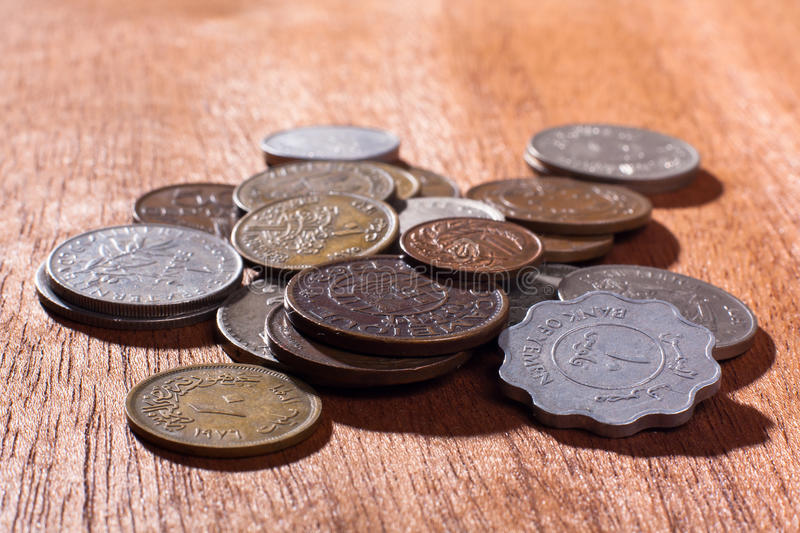Pile of coins on wooden background (selective focus used) royalty free stock photos