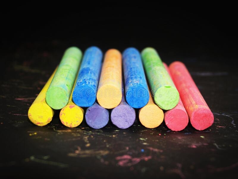 Pile Of Colored Chalk On Black Wooden Tabletop Free Public Domain Cc0 Image