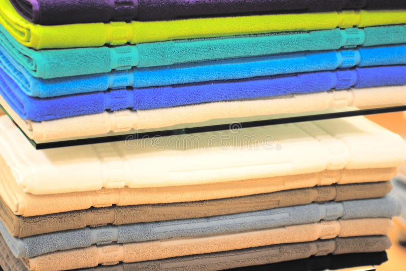 Pile Of Colored Towels On The Shelves Royalty Free Stock Photo