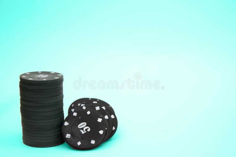 Pile of colorful casino chips in a corner border with different denominations isolated on white with copy space stock images