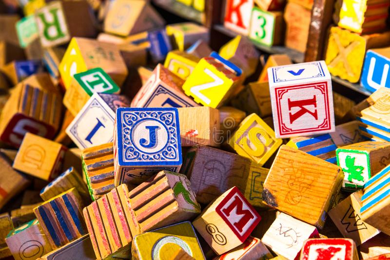 Pile of colorful children's vintage alphabet wooden block toys. Photograph of Pile of colorful children's vintage alphabet wooden block toys royalty free stock photography