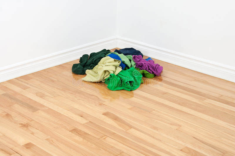 Pile Of Colorful Clothes In The Room Corner Royalty Free Stock Photography