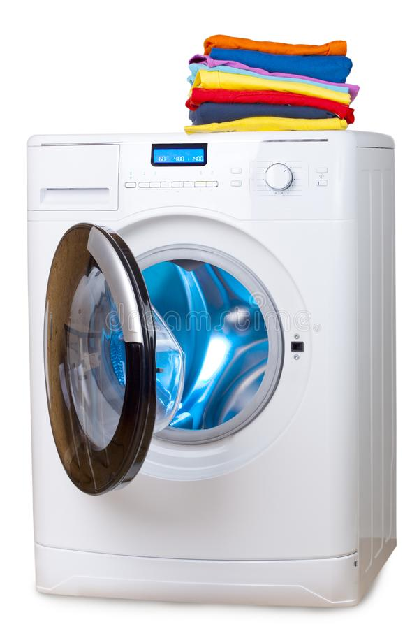 Pile of colorful clothes on the washing machine stock photos