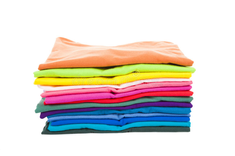 Pile of colorful clothes with white background royalty free stock photos