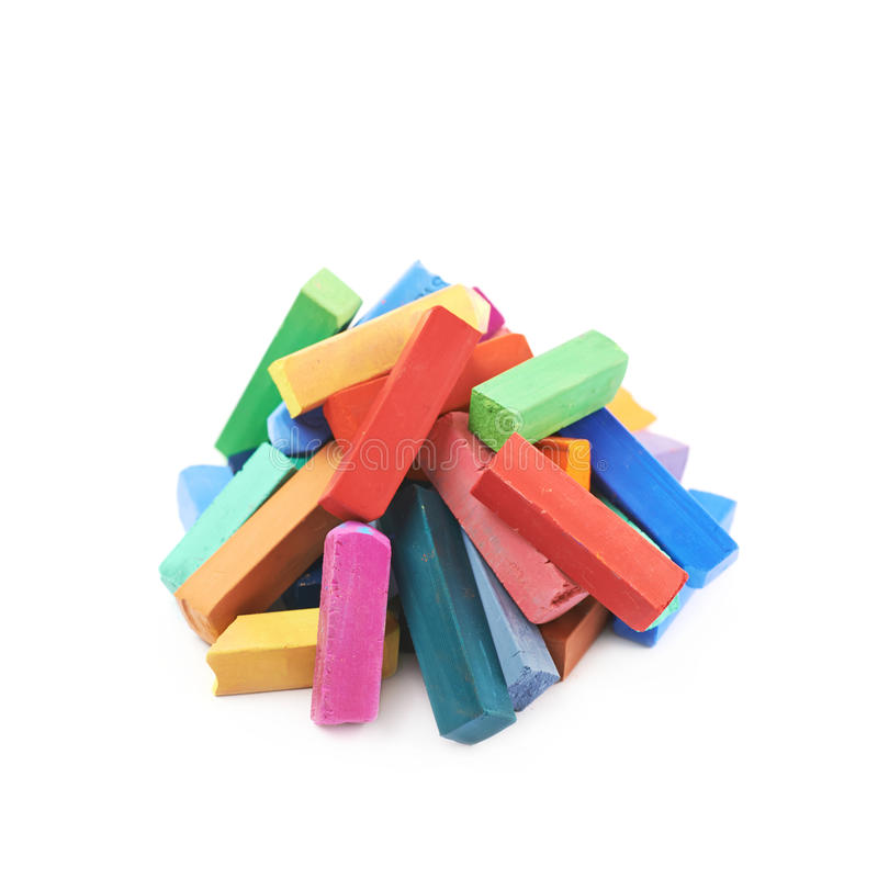 Pile of colorful pastel crayon chalks isolated. Over the white background stock images
