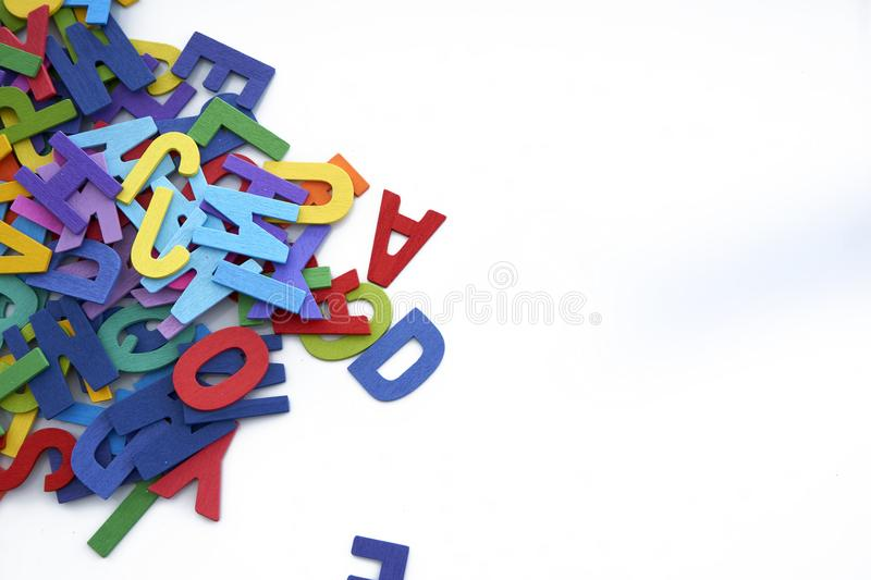 Pile of colorful wooden letters isolated over the white background with copyspace stock photos
