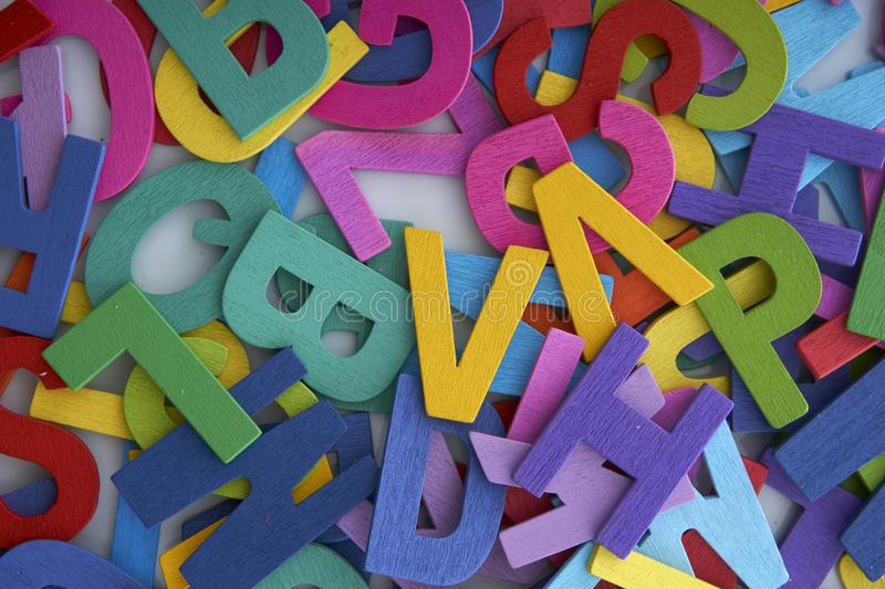 Pile of colorful wooden letters isolated over the white background with copyspace royalty free stock photo