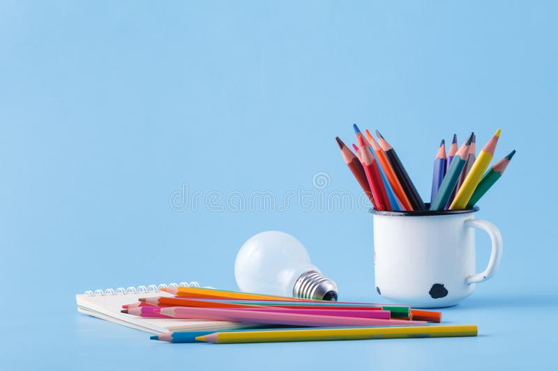 Pile of colour pencils on light blue background, creative idea c. Oncept royalty free stock photo