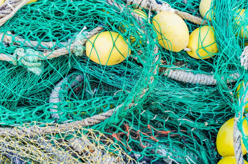 Pile of commercial fishing nets, ropes and buoys stock image