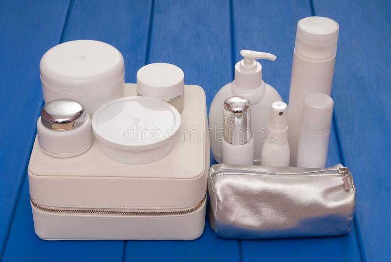 Pile of cosmetics is on the blue table stock image