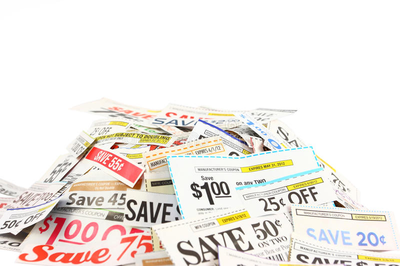 Pile Of Coupons On White. Money saving grocery coupons in a pile isolated on a white background royalty free stock photos