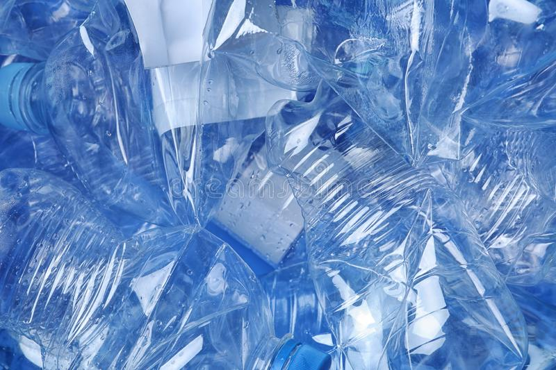 Pile of crumpled plastic bottles as background, closeup. Recycling problem stock images