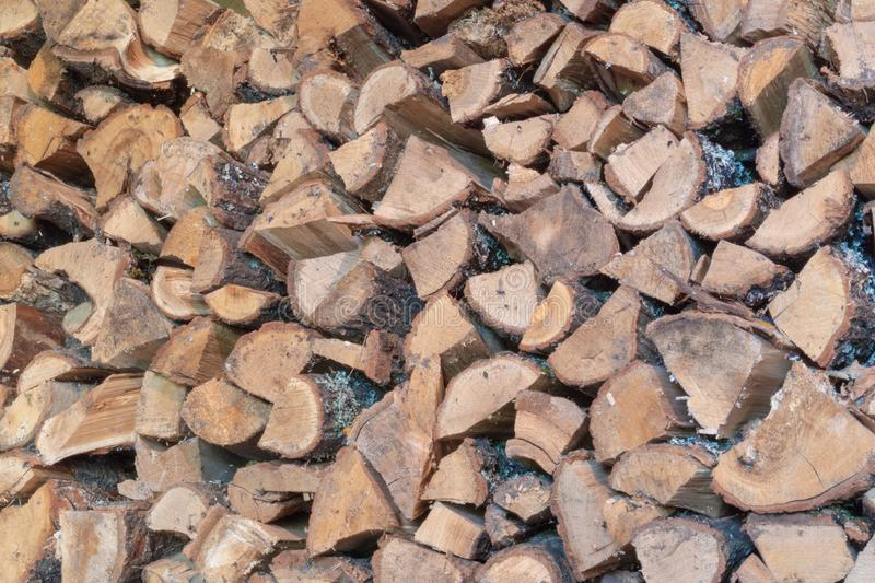A pile of cut firewood abstract texture. Lots of stacked wooden logs piling, tightly alligned. Wallpaper, background, repetitive royalty free stock image