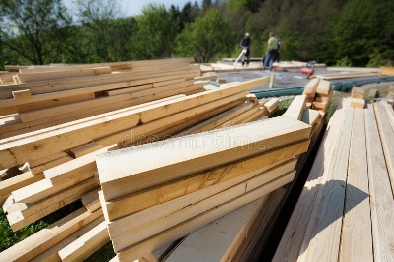 Pile of cut and prepared wood planks, beams and pieces royalty free stock photo