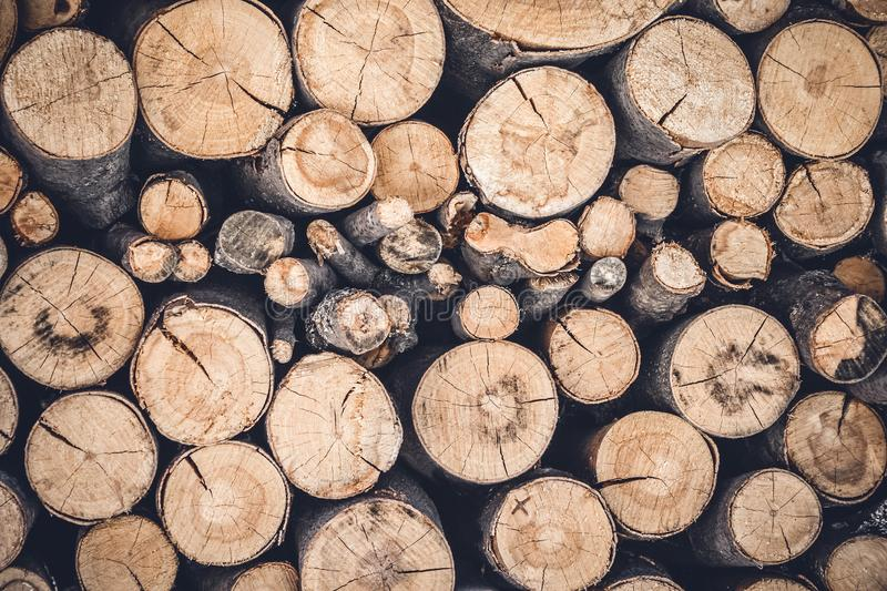 Pile of cut wooden logs. Stacked firewood background stock images