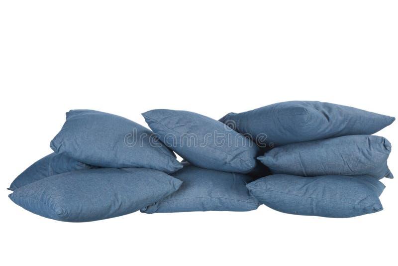 Pile d'oreillers bleus de denim image stock