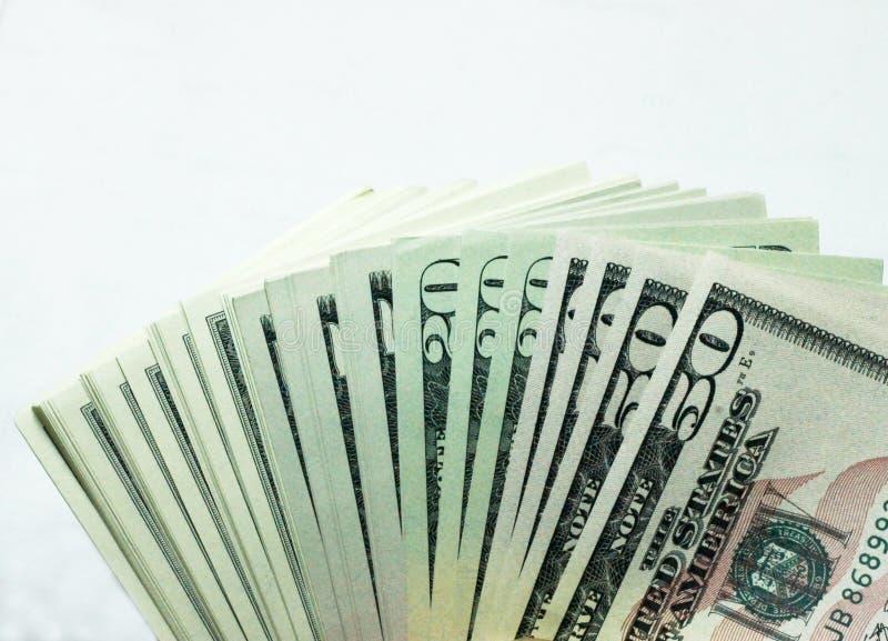 Pile de dollars Etats-Unis d'isolement sur le fond blanc photo libre de droits