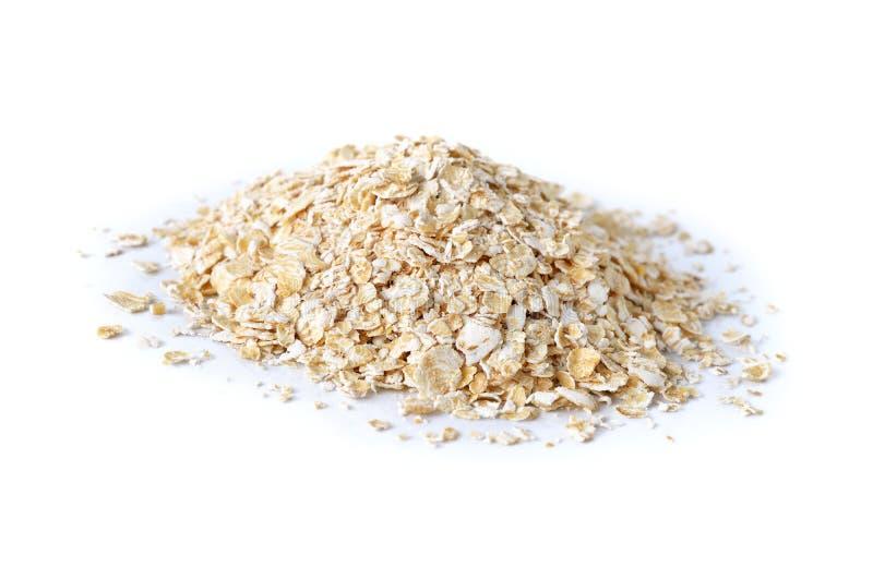 Pile de farine d'avoine instantanée sur le blanc images libres de droits
