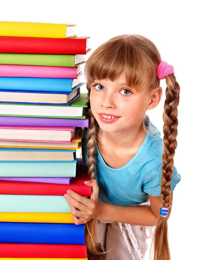 Pile de fixation d'écolière des livres. image stock