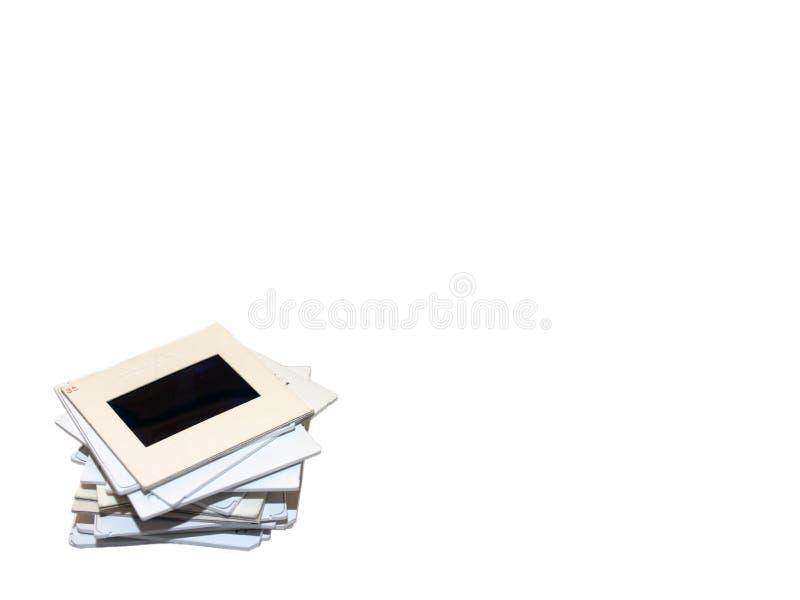 Pile de glissières sur le blanc photos stock