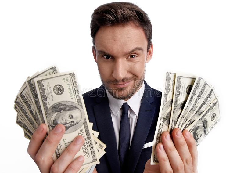 pile de participation d'homme d'affaires d'argent du dollar dans des ses mains image libre de droits