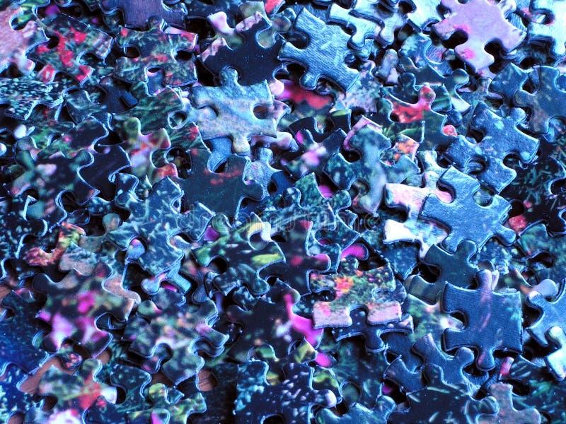 Pile de parties de puzzle : bleu photographie stock libre de droits