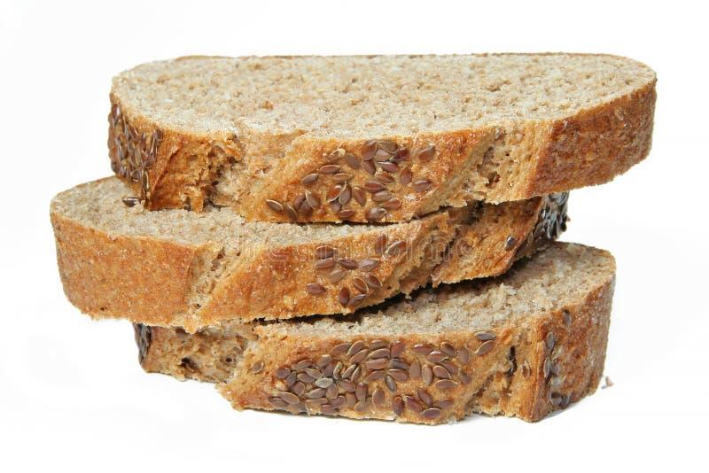 Pile de parts de pain de blé photo stock