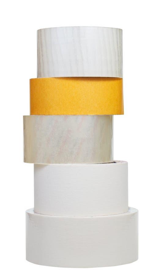 Pile de petits pains de ruban adhésif d'isolement sur le blanc photographie stock