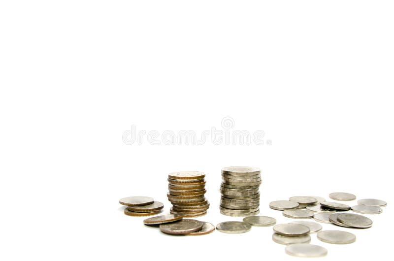 Pile de pièce de monnaie d'isolement sur le blanc photo stock