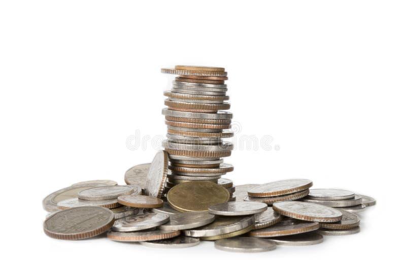 Pile de pièce de monnaie d'isolement sur le fond blanc photos libres de droits