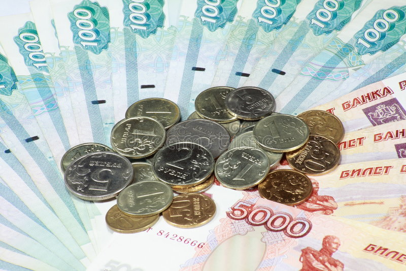 Pile de pièce de monnaie et d'obligation photo libre de droits