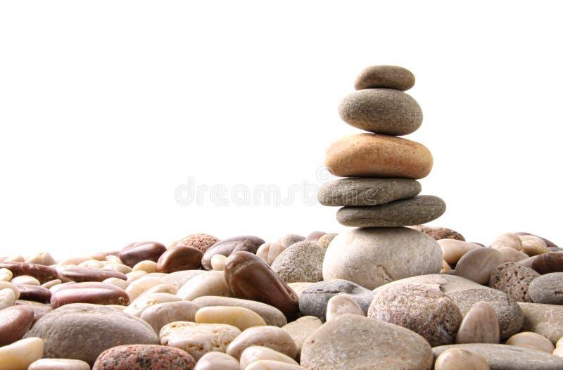 Pile de pierres de caillou sur le blanc photos libres de droits