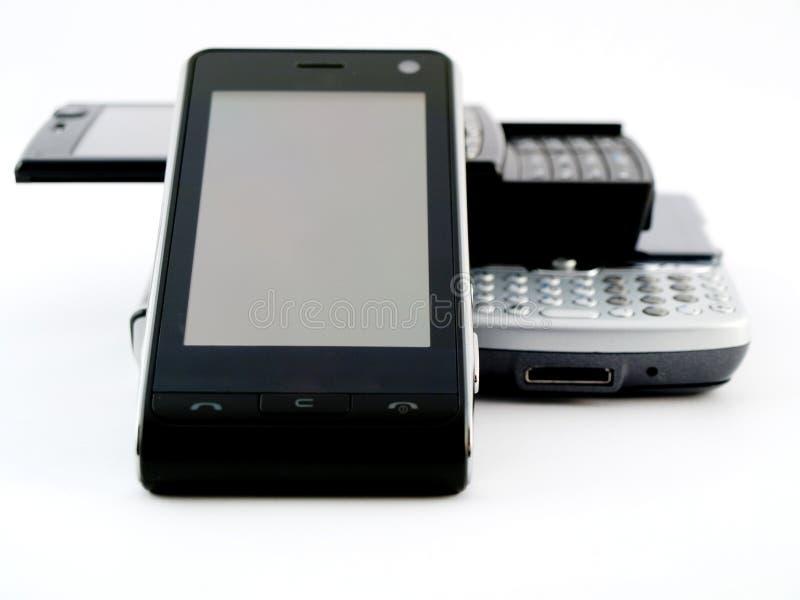 Pile de pile de plusieurs téléphones portables modernes PDA photos libres de droits