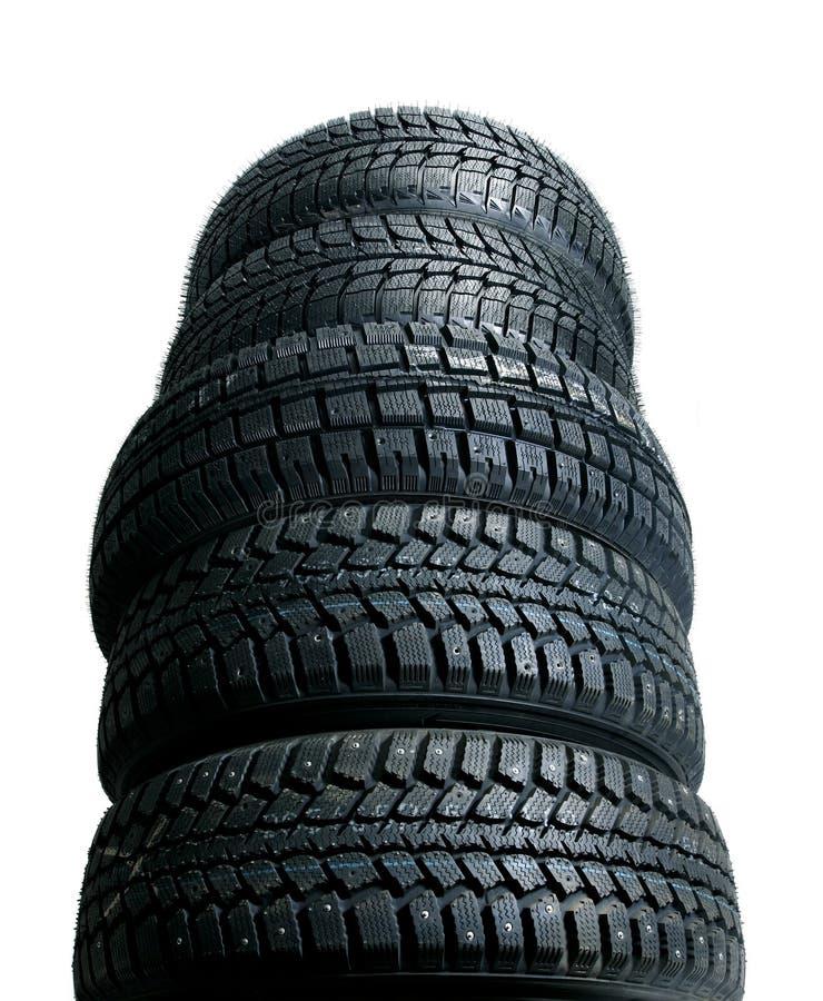 Pile de pneus neufs photo libre de droits