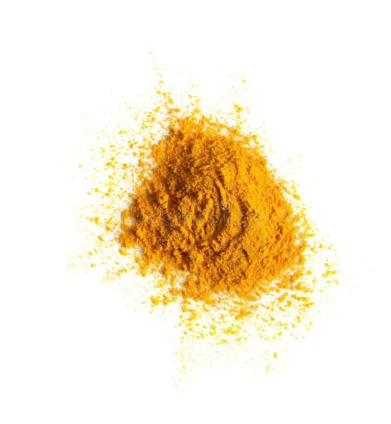 Pile de poudre de safran des Indes de safran des indes d'isolement sur le fond blanc, dessus images stock